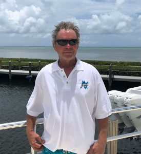 man wearing H-Blue-O Blue Marlin polo shirt